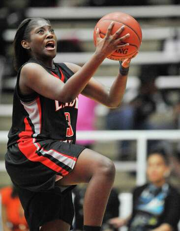 Port Arthur Memorial guard Ariel Hutchinson drives down the center to the basket against Fort Bend Hightower in the first half of their  5A area round playoff game at Phillips Field House in Pasadena.  Thursday, February 17, 2011.  Valentino Mauricio/The Enterprise Photo: Valentino Mauricio / Beaumont