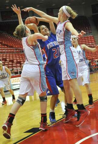 Lady Bruin, #21, Danielle Metoye, center, is swarmed by Lady Raiders as she tries to shoot the ball.  The Lumberton Lady Raiders and the West Brook Lady Bruins met on the court Thursday morning November 29, 2012 in a first round basketball game in the annual YMBL Basketball Tournament. The Bruins won 54-41.  Dave Ryan/The Enterprise Photo: Dave Ryan