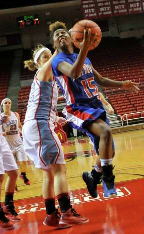 Lady Bruin, #15, Kiera Mickens goes for two points. The Lumberton Lady Raiders and the West Brook Lady Bruins met on the court Thursday morning November 29, 2012 in a first round basketball game in the annual YMBL Basketball Tournament. The Bruins won 54-41.  Dave Ryan/The Enterprise Photo: Dave Ryan