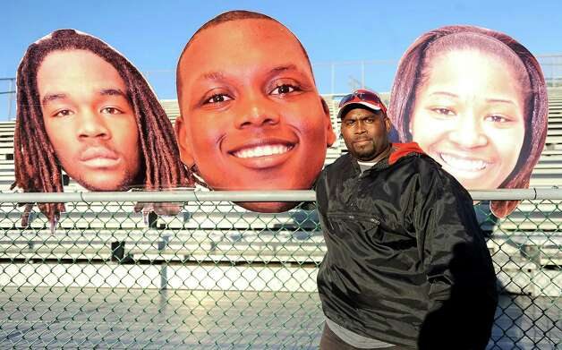 Jareem Augustine sells his big head creations cardboard cut outs of Jareem Augustine, Jr., Ryan Marks, and Crystal Sallier for fans to show support at Memorial Stadium in Port Arthur, Wednesday, December 7, 2011. Tammy McKinley/The Enterprise Photo: TAMMY MCKINLEY