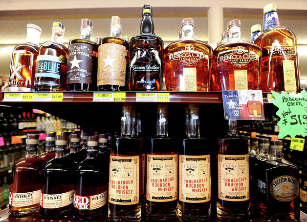 A row of Texas whiskey on a shelf at Sam's Package Store in Beaumont. Photo taken Thursday, February 21, 2013 Guiseppe Barranco/The Enterprise Photo: Guiseppe Barranco, STAFF PHOTOGRAPHER / The Beaumont Enterprise