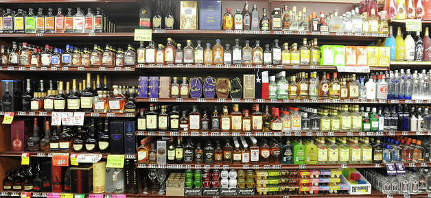 Shelved spirits at Sam's Package Store in Beaumont.  Photo taken Thursday, February 21, 2013 Guiseppe Barranco/The Enterprise Photo: Guiseppe Barranco, STAFF PHOTOGRAPHER / The Beaumont Enterprise