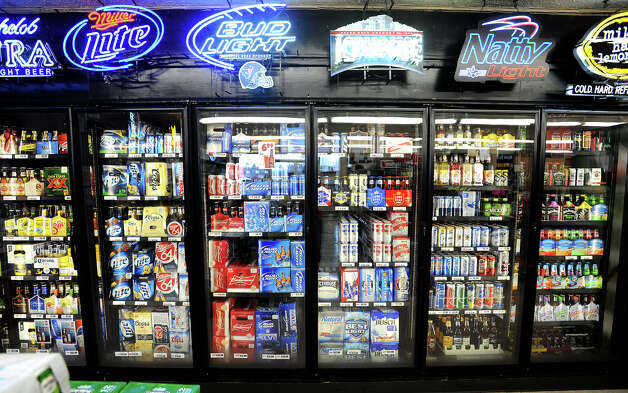 Beer coolers at Sam's Package Store in Beaumont.  Photo taken Thursday, February 21, 2013 Guiseppe Barranco/The Enterprise Photo: Guiseppe Barranco, STAFF PHOTOGRAPHER / The Beaumont Enterprise