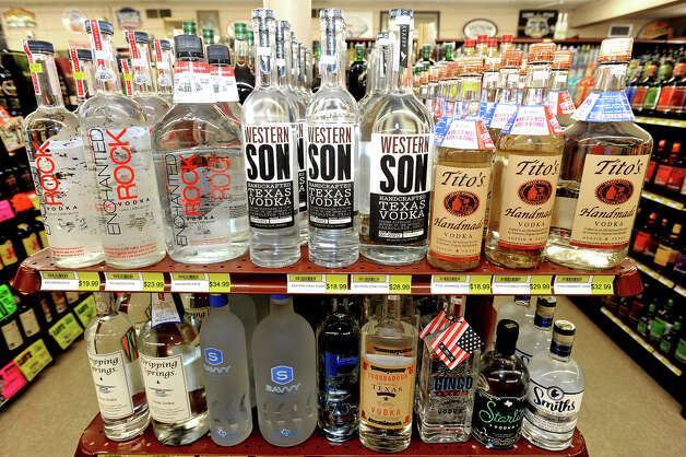 A row of Texas vodkas on a shelf at Sam's Package Store in Beaumont. Photo taken Thursday, February 21, 2013 Guiseppe Barranco/The Enterprise Photo: Guiseppe Barranco, STAFF PHOTOGRAPHER / The Beaumont Enterprise