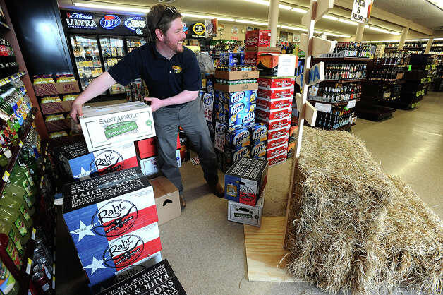 Jeff Wheeler prepares a display of Texas beers at Sam's Package Store in Beaumont. Photo taken Thursday, February 21, 2013 Guiseppe Barranco/The Enterprise Photo: Guiseppe Barranco, STAFF PHOTOGRAPHER / The Beaumont Enterprise