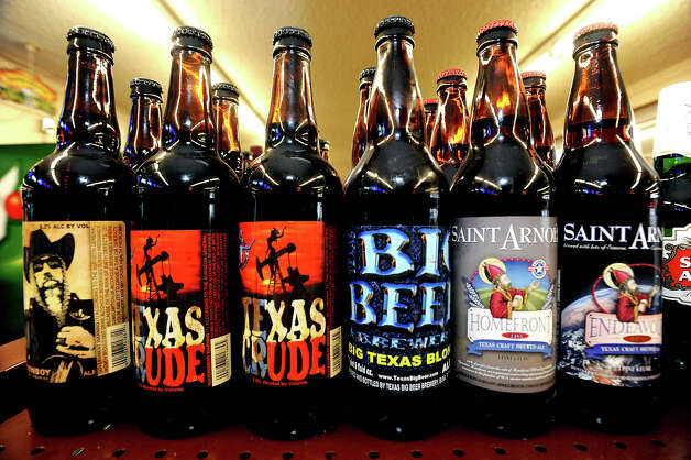 A row of Texas beers on a shelf at Sam's Package Store in Beaumont. Photo taken Thursday, February 21, 2013 Guiseppe Barranco/The Enterprise Photo: Guiseppe Barranco, STAFF PHOTOGRAPHER / The Beaumont Enterprise