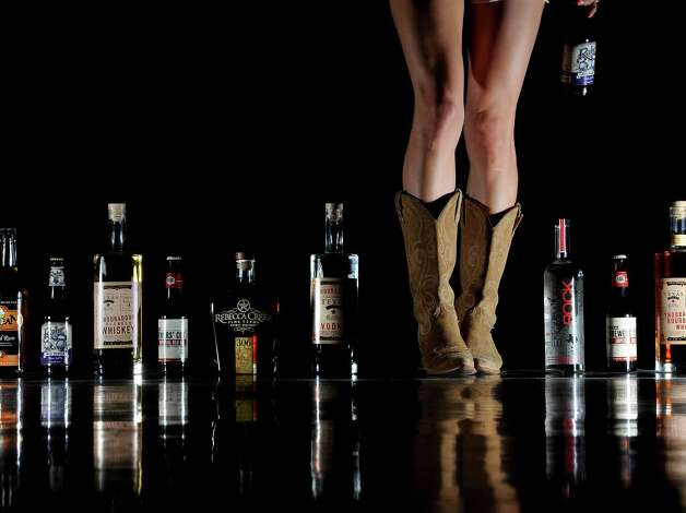 Boots and Booze Christina Segura and Texas beers and spirits from Debb's Liquor.  Photo taken Thursday, February 21, 2013 Guiseppe Barranco/The Enterprise Photo: Guiseppe Barranco, STAFF PHOTOGRAPHER / The Beaumont Enterprise