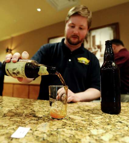 Jeff Wheeler pours a taster of the St Arnold Brewing Company Bishops Barrel 2 at the Texas craft beer tasting at Del Papa Distributing Company on Thursday, February 21, 2013. Photo taken: Randy Edwards/The Enterprise