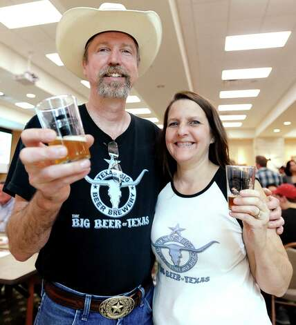 Johnny and Tammy McKissack of Texas BIG Beer Brewery cheers to a good time at the Texas craft beer tasting at Del Papa Distributing Company on Thursday, February 21, 2013. Photo taken: Randy Edwards/The Enterprise