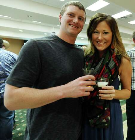 Clifton Franz and Allison Doty enjoy Texas craft beer at Del Papa Distributing Company on Thursday, February 21, 2013. Photo taken: Randy Edwards/The Enterprise