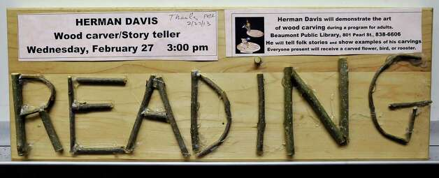 Herman Davis, a local woodcarver and story teller, was at the Beaumont Public Library Downtown branch this week, demonstrating his art of carving all types of wood, and telling his folk stories during a program for adults. He brought with him several large examples of carving that he has finished as well as continues to carve on.   Dave Ryan/The Enterprise