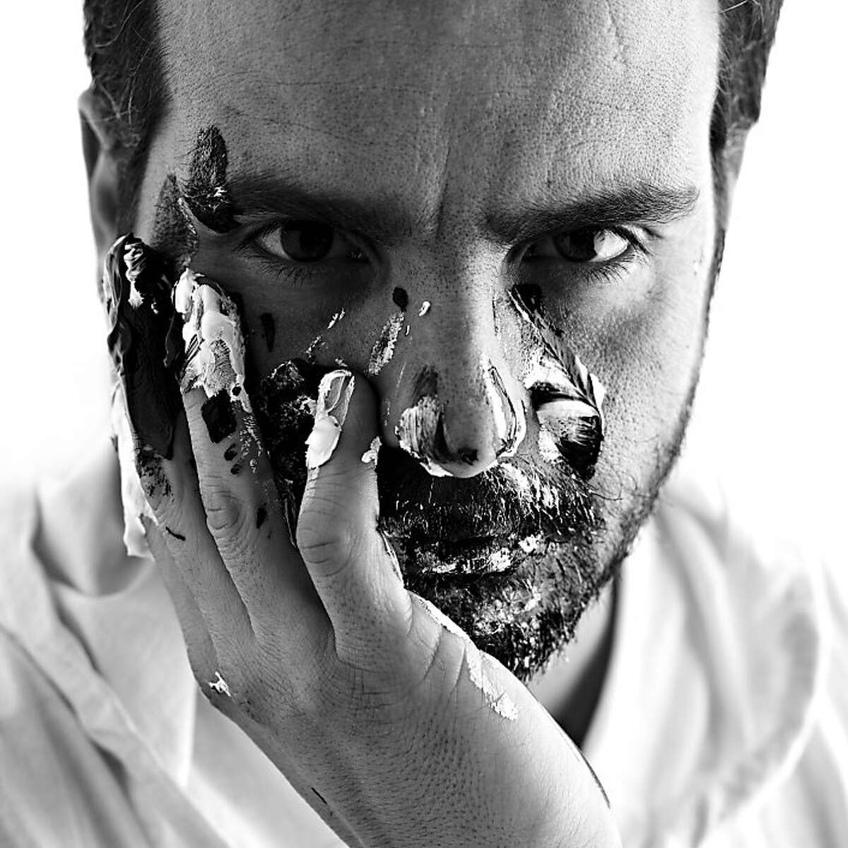 Italian painter Paolo Troilo paints his self-portraits by hand.