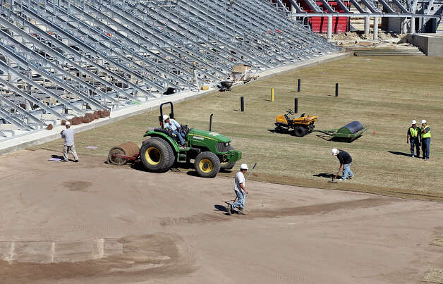 Workers lay the field at the new Toyota Field home of the San Antonio Scorpions Friday March 1, 2013. The teams' home opener is Saturday April 13, 2013 at 7:30 p.m. against the Tampa Bay Rowdies. Photo: Edward A. Ornelas, Edward A. Ornelas / San Antonio Express-News / © 2013 San Antonio Express-News