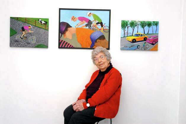 Henriette Simon Picker sits in front of threee recent paining done in 2013  at the PMW Gallery in Stamford, Conn. on Monday February 25, 2013. A retrospective show of her work will open at the gallery on March 3 and runs until April 14. Photo: Dru Nadler / Stamford Advocate Freelance
