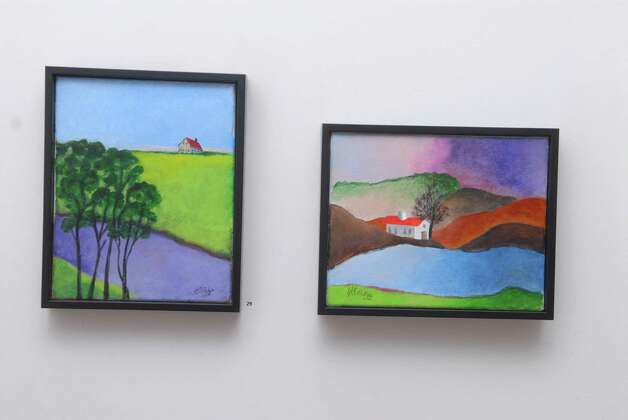 """Purple River"" and ""Red Roof"" are two ot the paintings by Henriette Simon Picker at the PMW Gallery in Stamford, Conn. on Monday February 25, 2013. The retrospective show will open at the on March 3. Photo: Dru Nadler / Stamford Advocate Freelance"