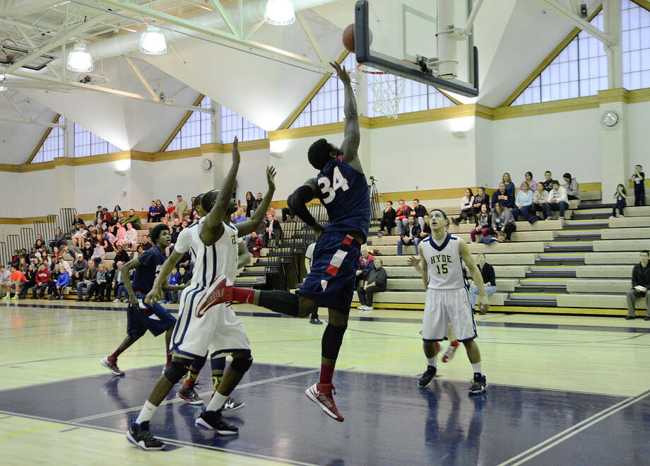 Greens Farms' #34 Sean Obi goes up for two as Greens Farms Academy hosts Hyde School in Class C New England semifinal basketball action at Coyle Gym in Westport, CT on Fri. March 1, 2013. Photo: Shelley Cryan / Shelley Cryan for the Stamford Advocate/ freelance Shelley Cryan