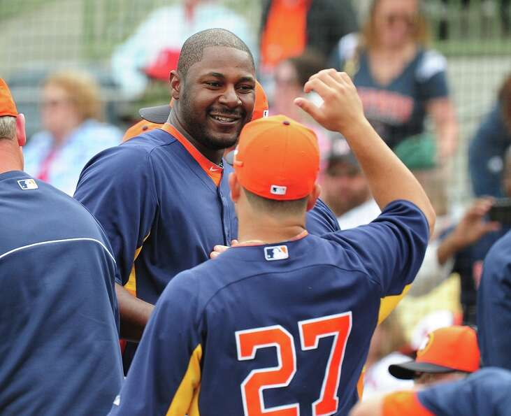 Astros 8, Cardinals 8Chris Carter is congratulated by Jose Al