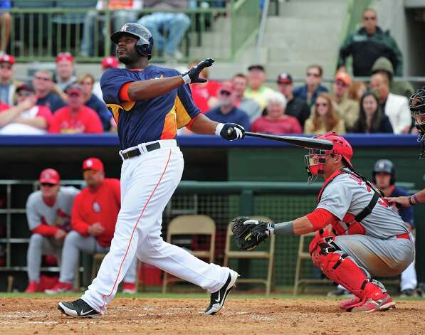 Chris Carter crushes a homer during the fifth inning. Photo: Scott Cunningham / 2013 Getty Images