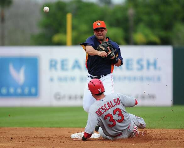 Jose Altuve turns a double play as Daniel Descalso slides into second base. Photo: Scott Cunningham / 2013 Getty Images