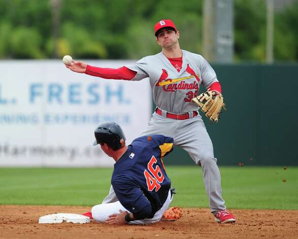 Pete Kozma turns a double play as Rick Ankiel slides into second base. Photo: Scott Cunningham / 2013 Getty Images