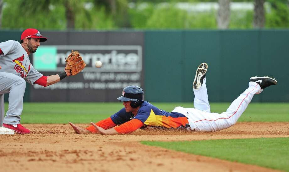 George Springer steals second base as Daniel Descalso attempts to field the throw. Photo: Scott Cunningham / 2013 Getty Images