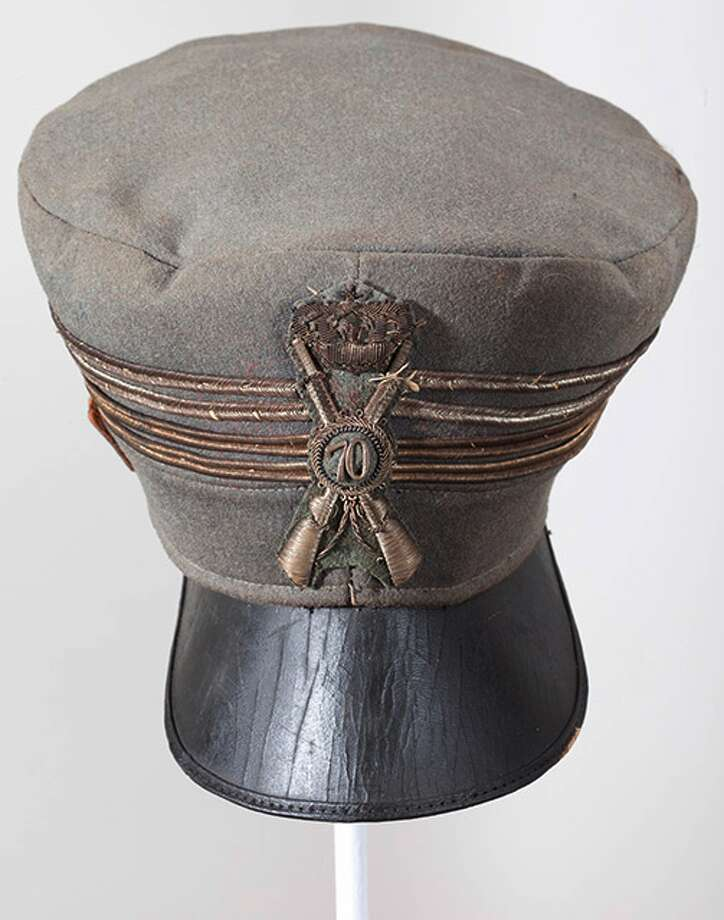 "Italian line infantry Colonel's hat from World War II (1939-1945). The cap features an embroidered line infantry insignia on the front with the number ""70"" in the middle. This number stands for the 70th Line Infantry Regiment. The cap band features four gold rank lines, indicating the rank of colonel."