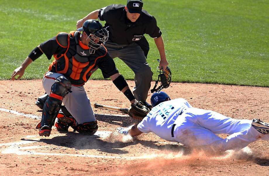 Giants catcher Guillermo Quiroz reaches to tag the Dodgers' Tim Federowicz on Tuesday. A legal play, now and forever. Photo: Lance Iversen, The Chronicle