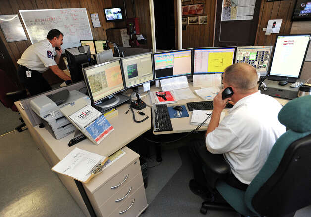 Partly due to an efficient emergency response system, Beaumont residents can soon expect a decrease in their insurance bill. David Lafley and, left, Darren Wallace answer emergency calls about a house fire in Beaumont. No injuries were reported from the fire. Photo taken Friday, March 01, 2013 Guiseppe Barranco/The Enterprise Photo: Guiseppe Barranco, STAFF PHOTOGRAPHER / The Beaumont Enterprise