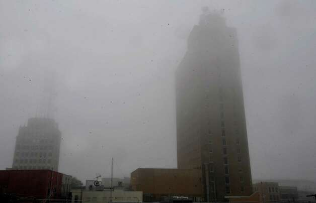 On Monday morning February 25, 2013,  Beaumont was blanketed in fog, causing everything, not on the ground per se, to be viewed in shades of gray.  I got the idea coming to work to just drive around and shoot scenes at random.  This is a view from our garage roof facing the old Gulf States Utilities building. Dave Ryan/The Enterprise