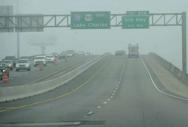 On Monday morning February 25, 2013,  Beaumont was blanketed in fog, causing everything, not on the ground per se, to be viewed in shades of gray.  I got the idea coming to work to just drive around and shoot scenes at random.  This is a view through my windshield coming up to the base of the Purple Heart Memorial Bridge over the river.  I could hardly see the billboard on the right. Dave Ryan/The Enterprise