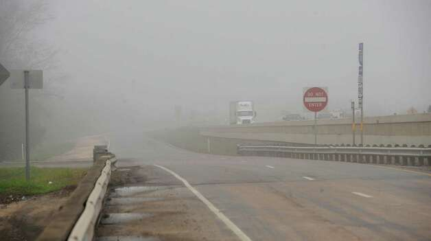 On Monday morning February 25, 2013,  Beaumont was blanketed in fog, causing everything, not on the ground per se, to be viewed in shades of gray.  I got the idea coming to work to just drive around and shoot scenes at random.  This is a view looking back west at the Purple Heart Memorial Bridge from the service road on the east bound side near Bairds Bayou.   Dave Ryan/The Enterprise