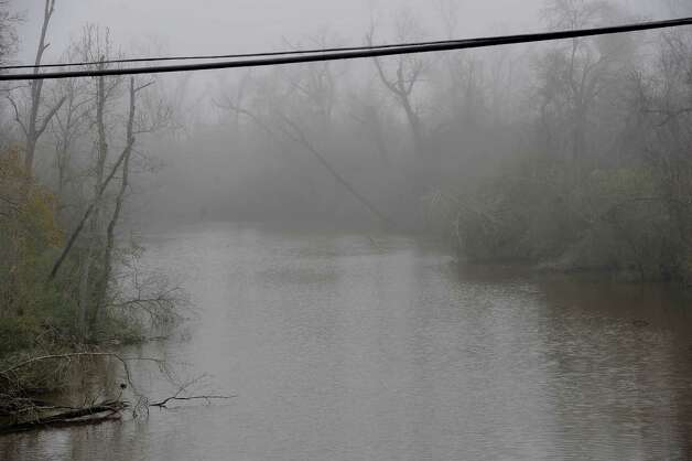 On Monday morning February 25, 2013,  Beaumont was blanketed in fog, causing everything, not on the ground per se, to be viewed in shades of gray.  I got the idea coming to work to just drive around and shoot scenes at random.  This is a fog coated Bairds Bayou as seen from the IH-10 service road east bound.   Dave Ryan/The Enterprise