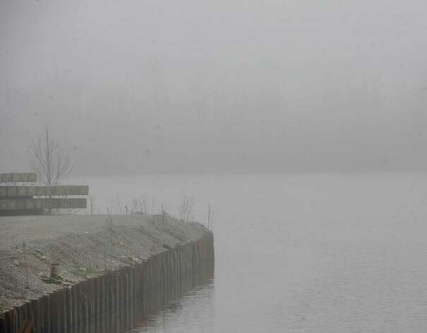 On Monday morning February 25, 2013,  Beaumont was blanketed in fog, causing everything, not on the ground per se, to be viewed in shades of gray.  I got the idea coming to work to just drive around and shoot things I saw at random.   This is a section of Bairds Bayou on the west bound side of the bridge.  Dave Ryan/The Enterprise