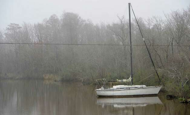 On Monday morning February 25, 2013,  Beaumont was blanketed in fog, causing everything, not on the ground per se, to be viewed in shades of gray.  I got the idea coming to work to just drive around and shoot things I saw at random.   In this area of Bairds Bayou on the west bound side of the bridge, there sat a single sailboat tied to the bank.  Dave Ryan/The Enterprise