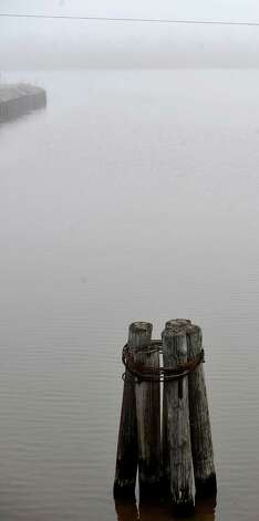 On Monday morning February 25, 2013,  Beaumont was blanketed in fog, causing everything, not on the ground per se, to be viewed in shades of gray.  I got the idea coming to work to just drive around and shoot things I saw at random.   This is a section of Bairds Bayou on the west bound side of the bridge.  These pilings were close to the service road. Dave Ryan/The Enterprise
