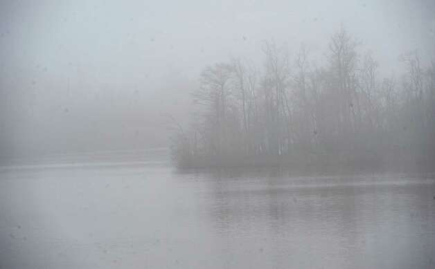 On Monday morning February 25, 2013,  Beaumont was blanketed in fog, causing everything, not on the ground per se, to be viewed in shades of gray.  I got the idea coming to work to just drive around and shoot things I saw at random.   This is a piece of Bairds Bayou as seen from the west bound service road near the bridge.  Dave Ryan/The Enterprise