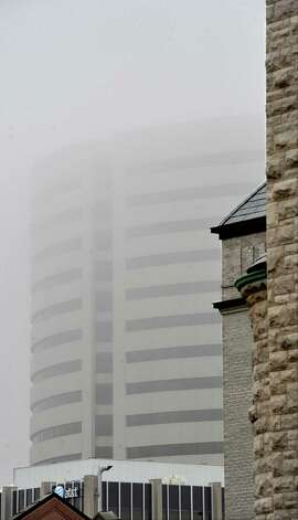 On Monday morning February 25, 2013,  Beaumont was blanketed in fog, causing everything, not on the ground per se, to be viewed in shades of gray.  I got the idea coming to work to just drive around and shoot scenes at random.  This shot is towards the Edison Plaza building from near the Tyrrell Library. The fog is beginning to lift.    Dave Ryan/The Enterprise