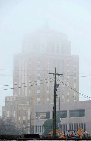 On Monday morning February 25, 2013,  Beaumont was blanketed in fog, causing everything, not on the ground per se, to be viewed in shades of gray.  I got the idea coming to work to just drive around and shoot scenes at random.  This shot is towards the Jefferson County Courthouse building from near River Front Park  The fog is beginning to lift.    Dave Ryan/The Enterprise