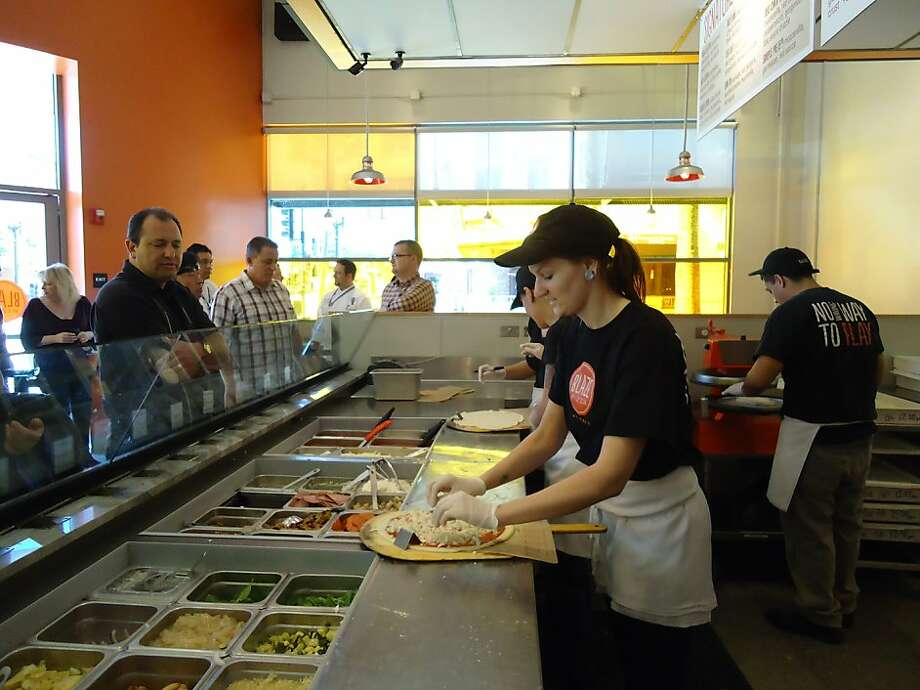 Workers at the Pasadena Blaze Pizza make pizzas to order in an assembly-line production process. Photo: Courtesy Of Blaze Pizza, Blaze Pizza
