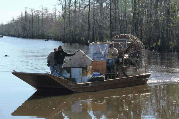 A group led by Stan Floyd of American Airboats and Airboat Rides cleared enough garbage from the Sabine River to fill a 30 yard trash bin. Included in the haul were 18 refrigerators and about 50 tires. Photo: Courtesy
