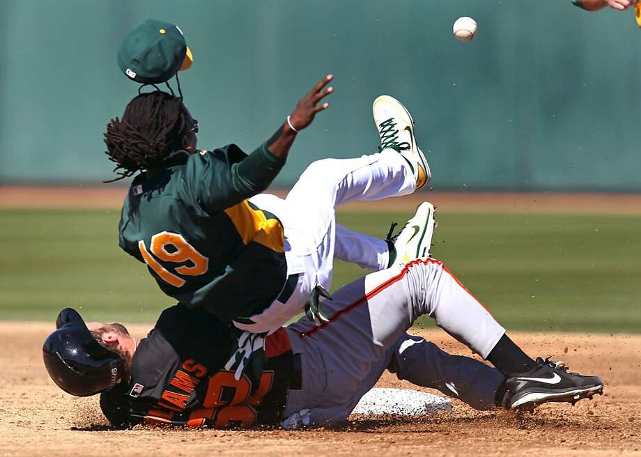 San Francisco catcher Jackson Williams takes out Oakland infielder Jemile Weeks at second base during the third inning. Photo: Lance Iversen, The Chronicle