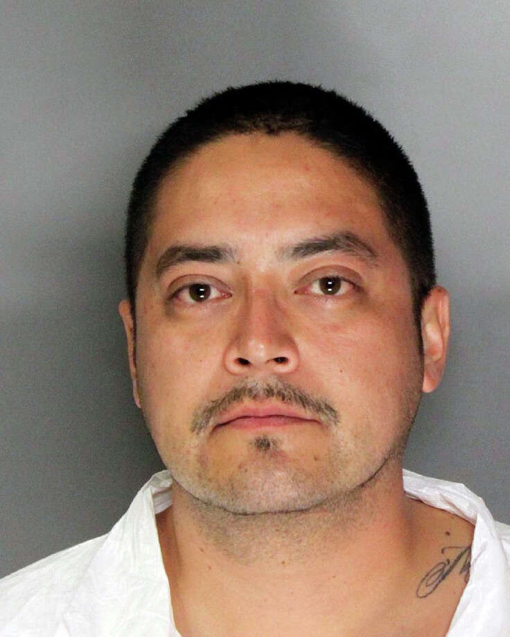 This photo provided by the Sacramento Police Department shows Phillip Raymond Hernandez. Hernandez accused of killing his 9-year-old son with a hatchet has served time in prison for domestic violence and had a bitter custody battle with the boy's mother, according to court records.  (AP Photo/Sacramento Police Department)