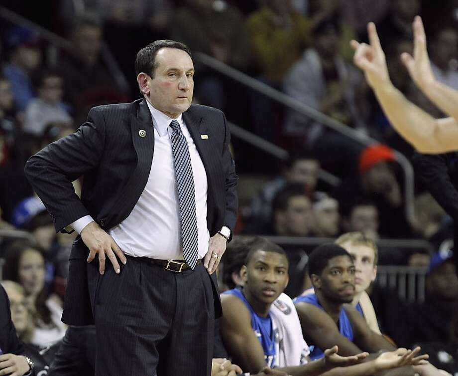 Duke head coach Mike Krzyzewski reacts to a foul call during the second half of an NCAA college basketball game against Boston College in Boston, Sunday, Feb. 10, 2013. (AP Photo/Mary Schwalm) Photo: Mary Schwalm, Associated Press