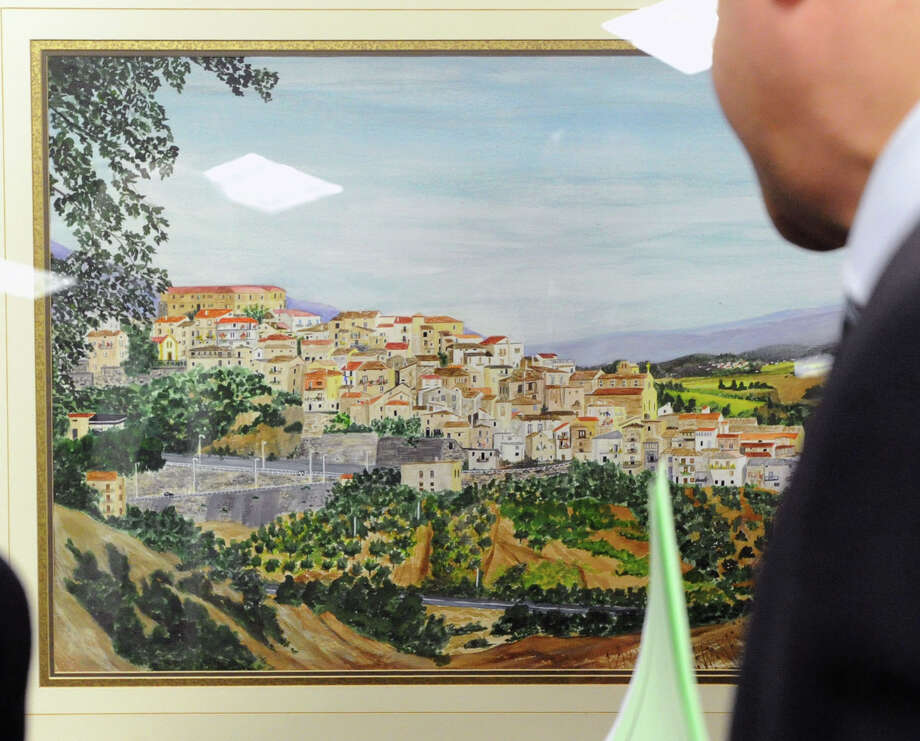 "A painting of the village of Rose in Calabria, Italy, was on display as part of the âÄúFrom Italy To America âÄù ceremony designating two towns in southern Italy, Morra De Sanctis in Campania and Rose, as sister cities of Greenwich, at Greenwich Town Hall, Friday night, March 1, 2013. Many of GreenwichâÄôs Italian-American residents emigrated from these two areas of Italy. Following the ceremony, the guests and Greenwich Historical Society members attended the opening of ""From Italy to America"" at the Greenwich Historical Society's Storehouse Gallery. The exhibition, which opens to the public Saturday, features a range of archival photographs, documents and objects dating from the 1880s that relate to the immigrant experience. Many of the items were collected during the Society's ""Discovery Days, "" which were held this past September through December. More than 100 people brought in objects for the exhibition that illustrate the experiences, traditions, challenges and contributions of Italian immigrants in Greenwich. Photo: Bob Luckey / Greenwich Time"