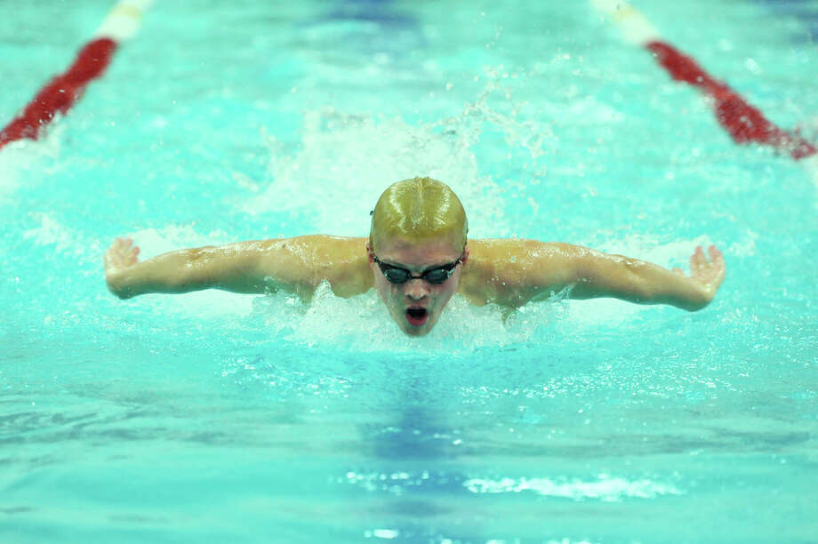 Pomperaug's James Davey competes in the mixed 100-yard butterfly final heat at the SWC boys swimming championship at Masuk High School in Monroe, Conn. Friday, March 1, 2013.  Davey placed first in the event. Photo: Tyler Sizemore / The News-Times