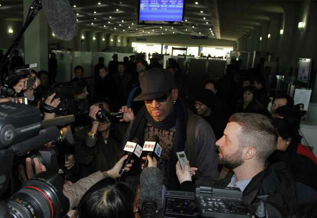 Former NBA star Dennis Rodman speaks to the media at the Pyongyang Airport before he leaves North Korea Friday, March 1, 2013.   Rodman hung out with North Korea's Kim Jong Un during his improbable journey to Pyongyang, watching the Harlem Globetrotters with the leader and later drinking and dining on sushi with him.(AP Photo/Kim Kwang Hyon) Photo: Kim Kwang Hyon