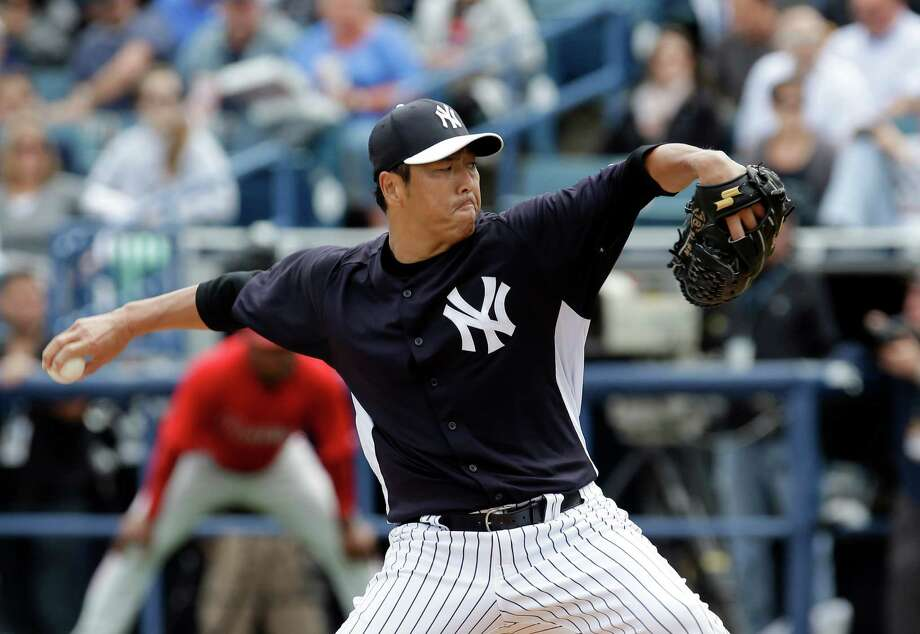 New York Yankees pitcher Hiroki Kuroda, of Japan, delivers to the Philadelphia Phillies in the first inning of a spring training baseball game Friday, March 1, 2013, in Tampa, Fla. (AP Photo/Chris O'Meara) Photo: Chris O'Meara