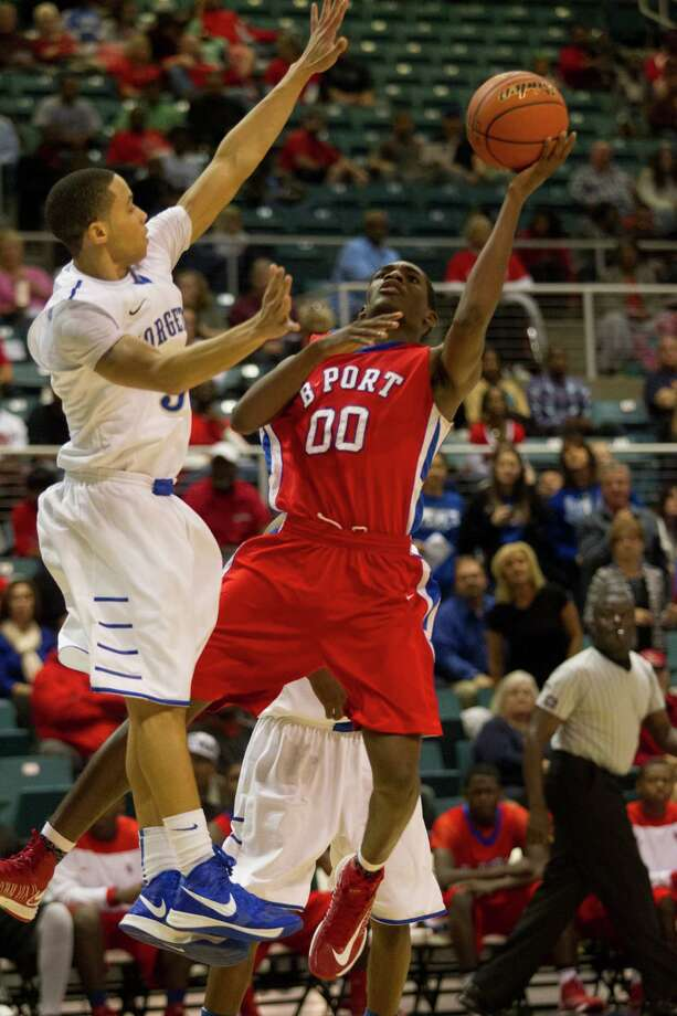 Brazosport guard Jaleen Smith (00) shoots over Georgetown guard Jean-Luc Parker during the 4A Region III tournament at the Merrell Center on Friday, March 1, 2013, in Katy. Photo: J. Patric Schneider, For The Chronicle / © 2013 Houston Chronicle