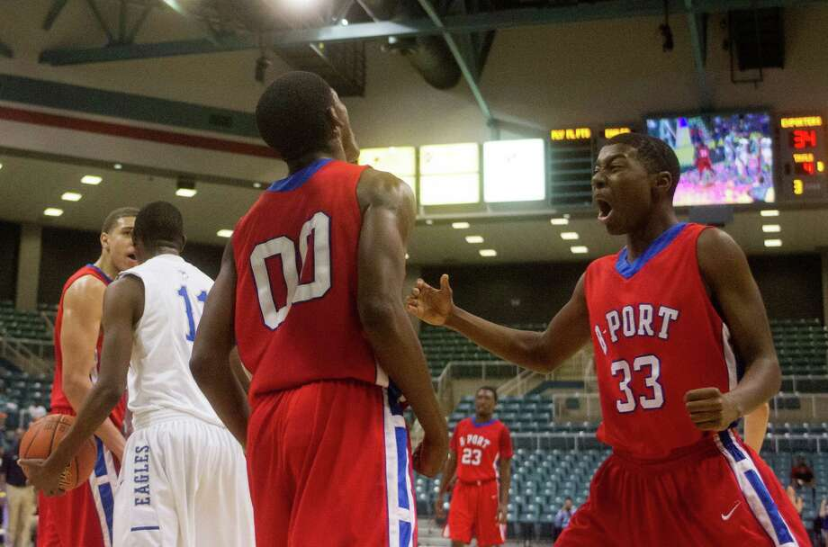 Brazosport guard Khalil Myers (33) celebrates after teammate Jaleen Smith (00) makes a basket during the fourth quarter of the 4A Region III tournament at the Merrell Center on Friday, March 1, 2013, in Katy. Photo: J. Patric Schneider, For The Chronicle / © 2013 Houston Chronicle