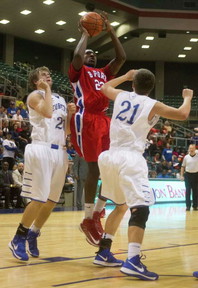 Brazosport guard Cameron Fisher (23) puts up a shot against Georgetown guard Jacob Vick (20) and forward Brad Huntsman (21) during the third quarter of the 4A Region III tournament at the Merrell Center on Friday, March 1, 2013, in Katy. Photo: J. Patric Schneider, For The Chronicle / © 2013 Houston Chronicle